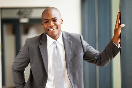 good guys: young african businessman in office