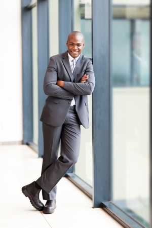 good business: young african american businessman full length portrait in office
