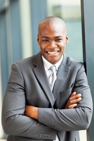 african american: happy young african american businessman portrait