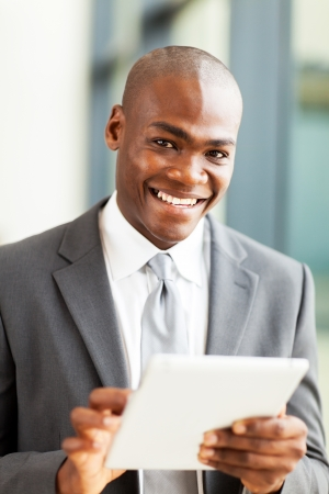 modern african businessman with tablet computer in office photo