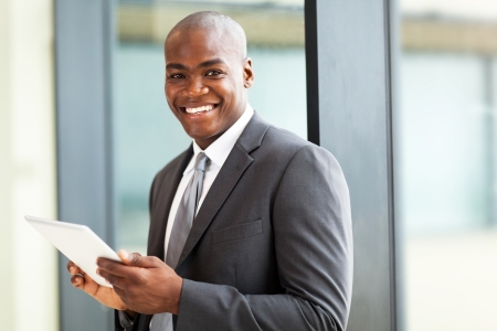 african businessman: male african american office worker with tablet computer Stock Photo