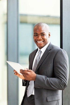 happy african american entrepreneur using tablet computer photo