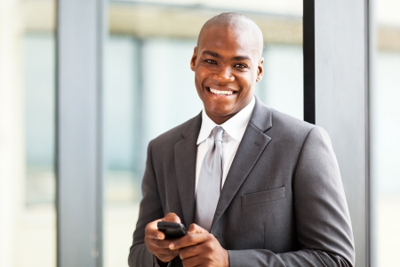 handsome african american businessman using a smart phone photo