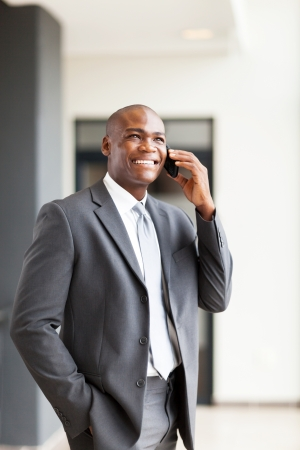 relaxed business man: handsome african american business executive talking on cellphone Stock Photo