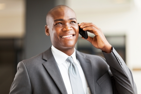 talking telephone: successful african american businessman talking on mobile phone Stock Photo