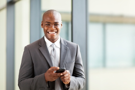 young african business executive with smart phone photo