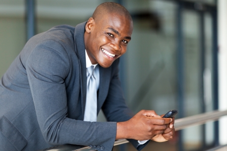 handsome african american business executive with smart phone Stock Photo - 16013938