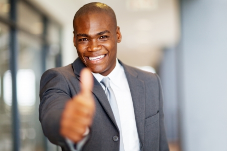 dressed up: successful african american businessman thumb up