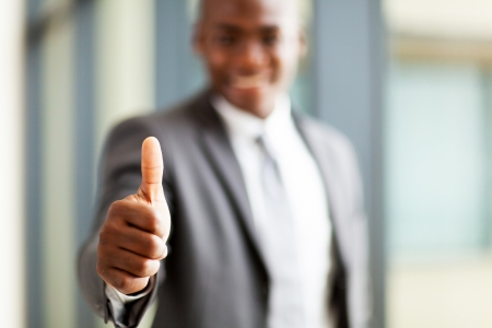 african american male: modern african american business executive thumb up