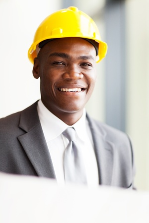 handsome african american architect with construction plan photo