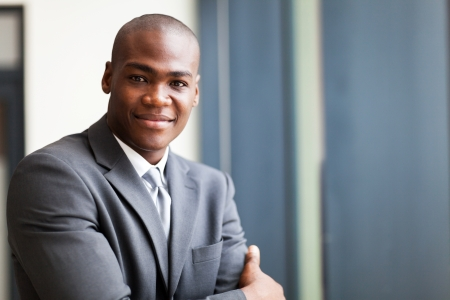 peaceful african american businessman in office photo