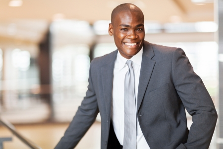cheerful african american business executive in office photo
