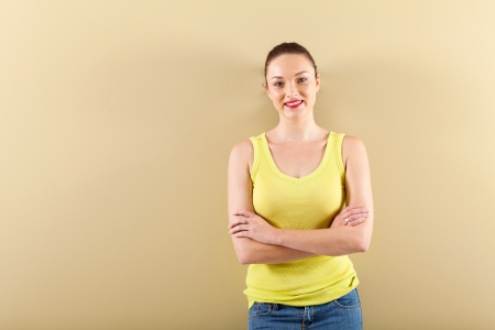 young woman standing in front of wall Stock Photo - 16729968