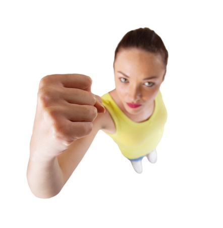 young woman punching with fist isolated on white Stock Photo - 16729957