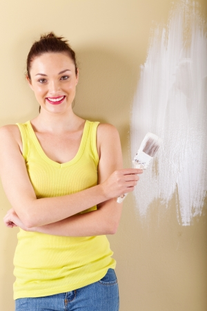 beautiful young woman with paintbrush  photo