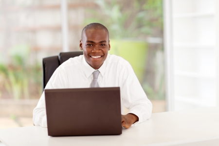 business men: happy young african american businessman in office