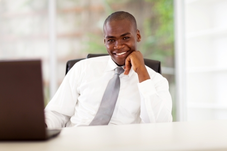 afro american: confident young african american businessman in office