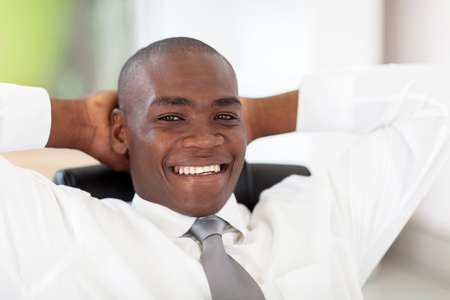 happy young african corporate worker in office Stock Photo - 16825082