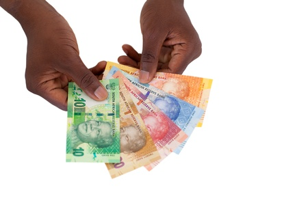 bank notes: south african man holding new bank notes