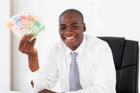 rand: african businessman with south african cash notes Stock Photo