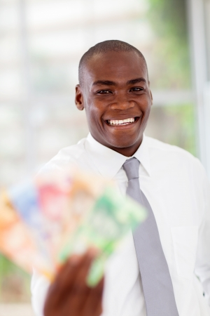 rand: happy young african businessman with cash notes Stock Photo