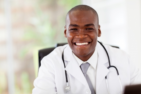 friendly african american doctor in modern office photo