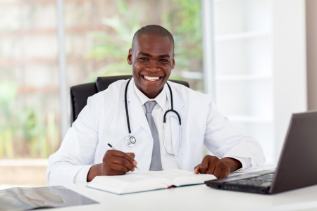 doctor with stethoscope: happy african american medical doctor in office