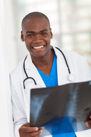 african american health care worker with x-ray photo