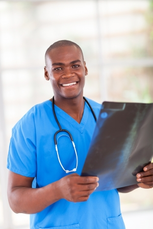 happy african hospital worker with x-ray Stock Photo - 16825076