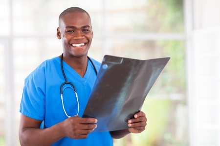happy young african medical worker with x-ray Stock Photo - 16825249