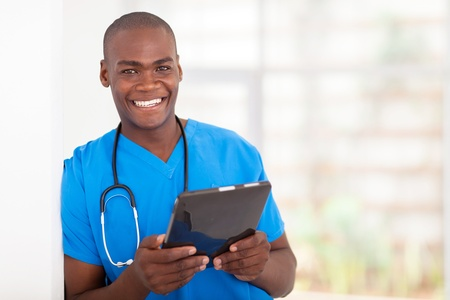 male nurse: happy young african american health care worker with tablet computer