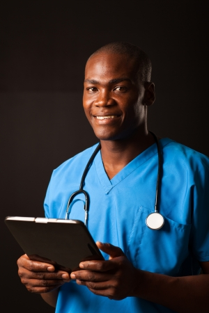 african american doctor en medicina con Tablet PC sobre fondo negro photo