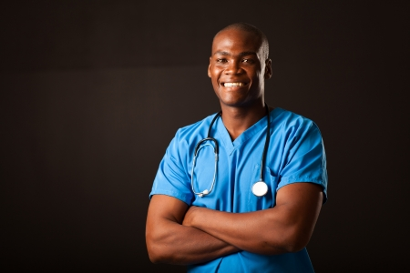 young african american medical doctor portrait over black background Stock Photo - 16825255