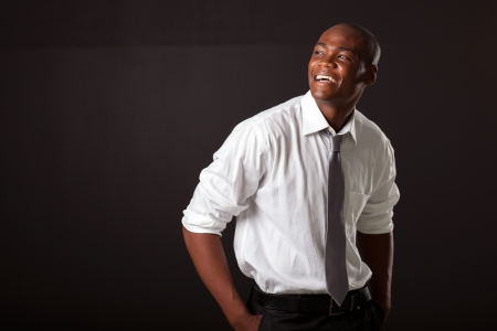 young african american man over black background photo