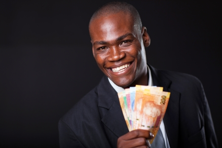 happy african businessman with south african cash notes photo