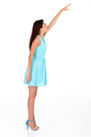 tall young woman reaching for something high photo