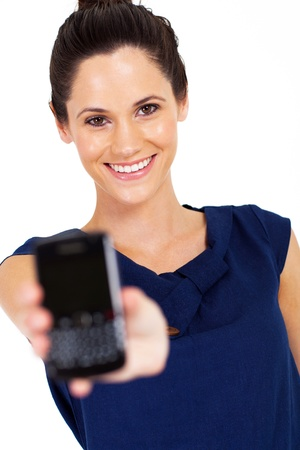 well dressed girl: gorgeous young woman holding smart phone towards camera