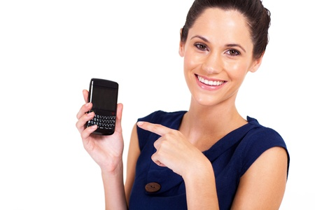 half dressed: attractive businesswoman pointing at smart phone isolated on white
