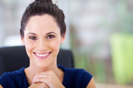 business dress: attractive young businesswoman closeup portrait