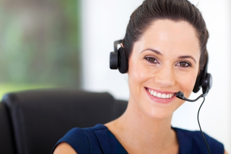 telephonist: cute young business call center operator with headphones