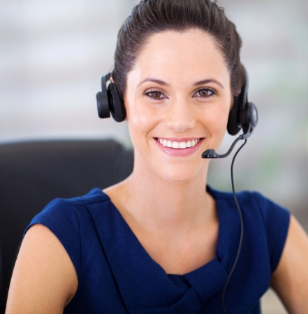 telephonist: pretty young telephonist with headphones closeup portrait Stock Photo