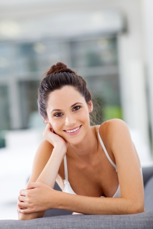 attractive young woman relaxing on sofa at home photo