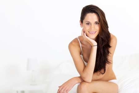 attractive young woman in underwear sitting on bed Stock Photo - 17232763