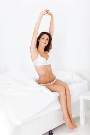 undergarments: pretty young woman waking up in the morning