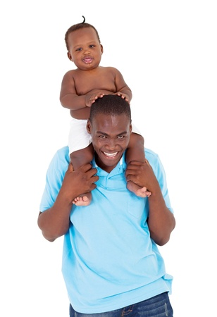 happy african baby boy sitting on father's shoulders photo