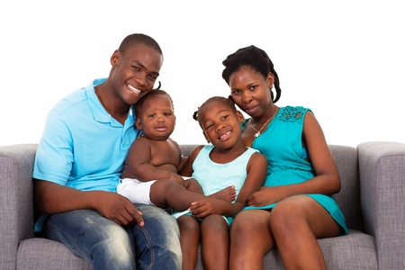 family on couch: happy african american family sitting on sofa Stock Photo