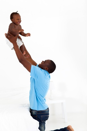 happy african american father and son playing in bedroom Stock Photo - 17365165