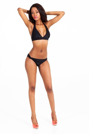 slim young african american woman in bikini on white background photo