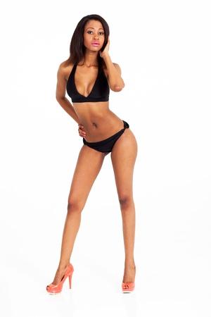 african bikini: sexy african american woman in bikini on white background