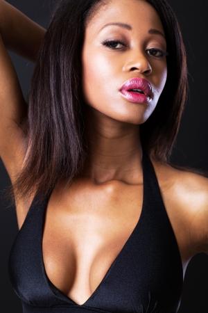 african bikini: young african beauty closeup on black background